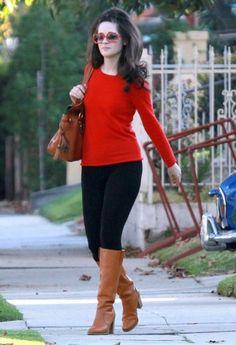 Zoey Deschanel struts her stuff with her Florentine Smith Bag