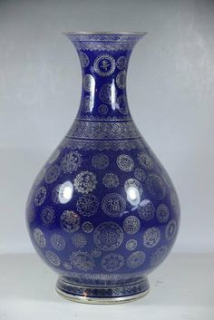 """CHINESE BLUE PORCELAIN VASE Blue Porcelain Vase with white color textures Dimension: 14"""" H"""