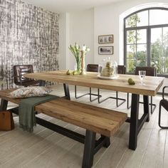 Distressed wood table & bench. Metal legs. Industrial modern design.