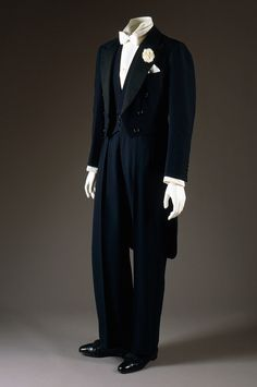 Midnight blue evening tailcoat and dress vest by Frederick Scholte for the Duke of Windsor, 1938.  Trousers by H. Harris, New York, 1965, as a copy to replace the 1938 original.