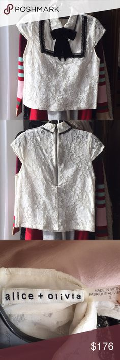 """Alice + Olivia Bow Tie Lace Blouse """"Vanetta"""" Pintuck Bib Lace Shirt with Velvet Bow. Zipper back. The bow tie unclasps at the back but is sewed to the shirt in the front by 1 thread, so it can easily be removed if you choose to cut it. Item dry cleaned before packaged. Alice + Olivia Tops Blouses"""
