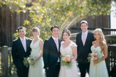 Groomsmen in dark suits and bridesmaids in pale mint dresses. | see more of this stunning California wedding here: http://www.mywedding.com/articles/yan-and-maureens-lovely-la-jolla-ca-wedding-by-heidi-o-photo/