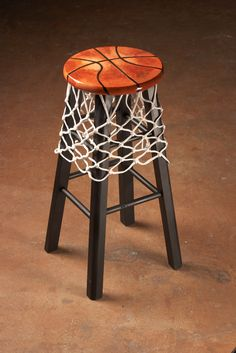 Add a basketball net to your kitchen stools and decorate the seat with black tape in the shape of a basketball.