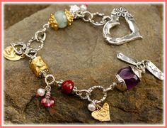 Joy and Passion Too  -Handcrafted sterling silver links, charms and toggle -Some 23kt gold vermeil over sterling -Faceted Aquamarine -Faceted Ruby -Faceted AA Pink Sapphire -Freshwater Pearls -Smooth Amethyst Nugget -Pink Tourmaline