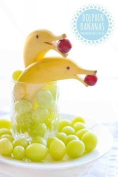 No-cook dolphin bananas #onehandedcooks #banana #toddlerfood #kidsfood #recipes #kids #grapes #snacks #healthy by caitlin