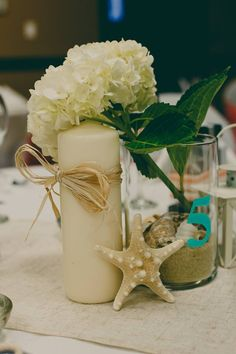 Nicole & Nelson's Wedding - Centerpieces - Beach Club July 2016 -  Beach Theme, Outdoor Ceremony, Indoor Reception - Island Moments Photography, Nanaimo / Parksville / Vancouver Island - Wedding Decor, Pillar Candles, Table Centerpiece, Guest Table, Starfish, Hydrangeas Table Centerpieces, Wedding Centerpieces, Reception Decorations, Table Decorations, Ceiling Draping, Island Weddings, Vancouver Island, Outdoor Ceremony, Hydrangeas