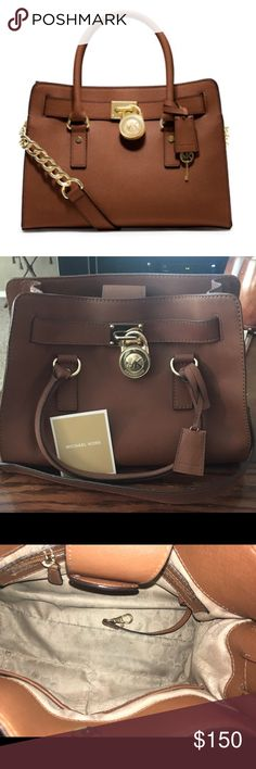 Michael Kors Hamilton Bag This bag is in great used condition. Still holds its shape excellently and there is only one minor flaw in the leather (pictured) but that can be polished out I estimate! The inside has usual wear (small pen marks, etc). I've tried to depict every flaw as accurate as possible.                     100% AUTHENTIC Michael Kors Bags
