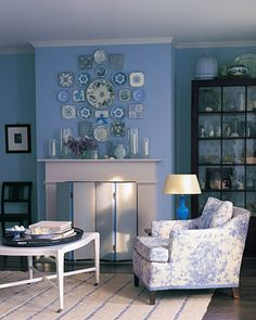 Blues don't need to be saved for a baby's room. Here, a classic blue is the perfect backdrop for a collection of antique plates.