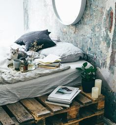 Gravity Home: Bedroom with a pallet bed and an unfinished wall