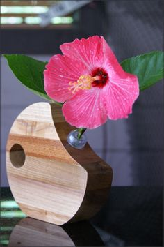 This handcrafted wooden bud vase holds precious buds of your favorite flowers. Dress up the vase with a single flower for a beautiful display. Featuring a variety of hardwoods and shapes these bud vases will add the perfect finishing touch to any room in your home. The flower bud tube holds water and is inserted into the center of the wooden vase. A truly extra special gift for many occasions. http://woodsmithofnaples.com/wooden_bud_vase_5.html