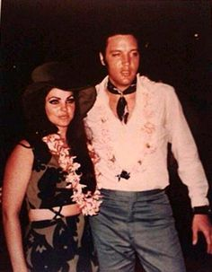 Elvis in may 28 1968 in Hawaii,here with Priscilla.