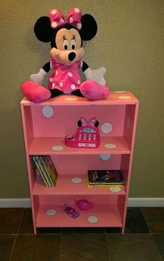 a broken,thrift bookcase, redone into pink w/white polka dots, perfect for Minnie Mouse Room :)  Suzanne Wright Photography