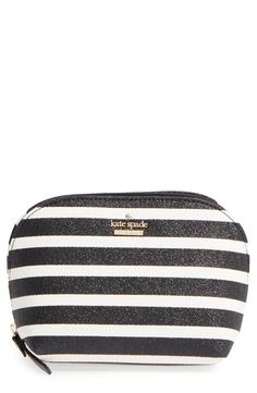 Glittery black-and-white stripes add uptown pizzazz to this compact Kate Spade cosmetics case perfect for storing the everyday essentials.