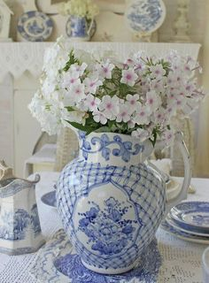 Fresh flowers arranged in blue and white china
