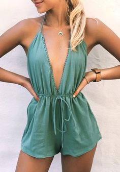 Stay cool all throughout summer with this breezy green plunge halter romper.