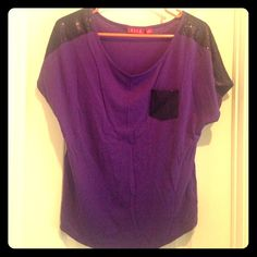 Purple and Black Sequin Tee This amazing purple tee has black sequin details on the shoulder and on the front pocket. Great condition - only worn once. Size medium but fits more like a large. Tops