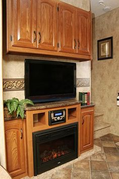 Entertainment center with fireplace Home Entertainment Centers, Entertainment Furniture, Keystone Rv, Nature Artwork, Home Comforts, And So The Adventure Begins, Media Center, Organizing Ideas, Basement
