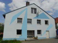 Moderne Fassade mit geometrischen Formen vom Malerbetrieb R. Jäger GmbH in Marsberg (34431) | Maler.org
