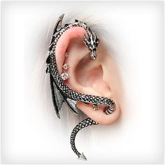 Let A Dragon Be Your Guide: Dragon Ear Wrap Ear be dragons! This Dragon Ear Wrap is just about the coolest piece of jewelry ever. This gleaming reptile curves around your ear and whispers all of his secrets and magical advice just to you. Ear Jewelry, Cute Jewelry, Body Jewelry, Jewelry Accessories, Steel Jewelry, Unique Jewelry, Women Accessories, Gothic Earrings, Stud Earrings