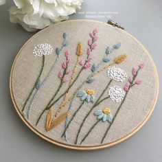 Floral Embroidery Hoop Art by And Other Adventures Embroidery Co A field of flowers that will never fade away. This freehand embroidery is hand-stitched on to oatmeal colored linen and featured in a embroidery hoop. Hand Embroidery Projects, Floral Embroidery Patterns, Hand Embroidery Videos, Embroidery Flowers Pattern, Hand Embroidery Stitches, Embroidery Hoop Art, Hand Embroidery Designs, Crewel Embroidery, Vintage Embroidery