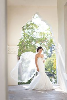 WEDDINGS – norrisphoto #norrisphoto - A gorgeous bright sunny arch for our bride to take a mesmerizing portrait. With the beautiful architecture and wind gently blowing her veil, she appears so lovely in her mermaid cut wedding dress. Los Angeles and destination wedding photographer brings the dream to life. #mermaidcutweddingdress #architecturalweddingphotos #weddingphotographerlosangeles