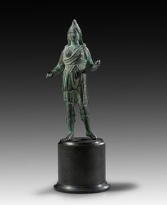 Bronze figure of Artemis Bendis in oriental dress with Phrygian cap. Roman Imperial Period, 1st - 2nd century A.D. Sea patina with encrustation.