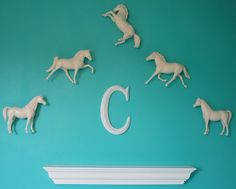 Anythingology: Sophisticated Decor For A Horse Loving Girl  Breyer Horses painted white and hung on the wall~Painting The Collectibles?~What Say You Girls?~