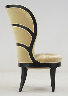 An Uno Åhrén Swedish Grace lady´s armchair, Mobilia, Sweden ca 1925.  Lacquered in black, original upholstery in light yellow coloured velvet plush. Label marked