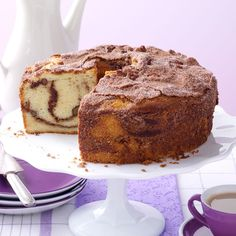 Cinnamon Coffee Cake Recipe -I love the excellent texture of this old-fashioned streusel-topped coffee cake. Always a crowd-pleaser, its pleasing vanilla flavor enriched by sour cream may remind you of breakfast at Grandma's! —Eleanor Harris, Cape Coral, Florida