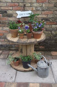 Create budget friendly & playful indoor/outdoor resources by upcycling and repurposing wooden spools and cable reels. Clever ideas to inspire early childhood teachers and parents. Wooden Cable Reel, Wooden Cable Spools, Cable Reel Ideas Garden, Back Gardens, Outdoor Gardens, Indoor Outdoor, Cable Drum Table, Outdoor Coffee Tables, Garden Table