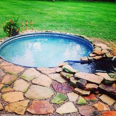 #1. Build a flagstone pavers deck around galvanized tank pool and add a simple waterfall.