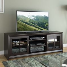 Accommodates TVs Up To 70 Inches. This Solid Wood TV Stand Has Built In  Cable