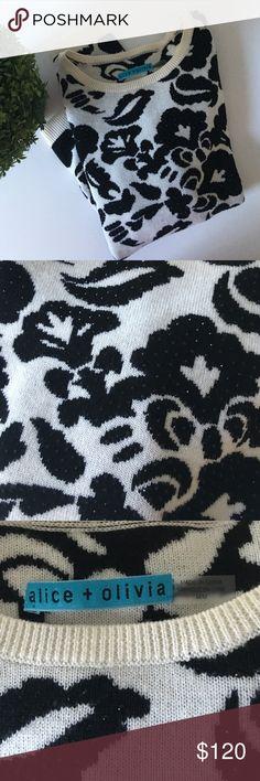 Alice + Olivia B&W Sparkle Sweater Stunning high quality soft wool B&W floral sparkle sweater by Alice + Olivia. 100% wool/laine. Size Medium. NWOT. Alice + Olivia Sweaters Crew & Scoop Necks