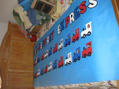 Jeffrey Express Banner - train cars for each kid at the party with their pictures in the window