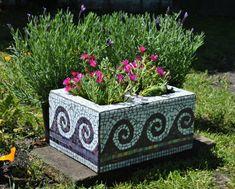 mosaic tiles on cinder block - cute