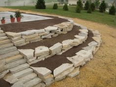 Your backyard landscaping is going to have to be about many different things but the most important one of these if your well being. Most people get into backyard landscaping because they want to change the look and feel of their home Landscaping On A Hill, Landscaping Retaining Walls, Small Backyard Landscaping, Landscaping With Rocks, Landscaping Ideas, Rock Retaining Wall, Terraced Landscaping, Sloped Yard, Garden Steps
