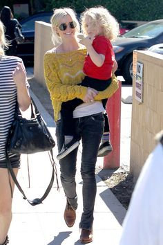 98bf3a2d1dc8 A dashing Ashlee Simpson toting the little one. Ashlee Simpson