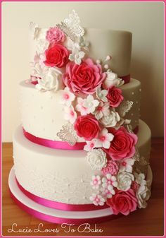 Fuchsia pink and white wedding cake created by #lucielovestobake with edible lace patterned tiers, piped polka dots, lace butterflies and handmade sugar roses and flowers -x-