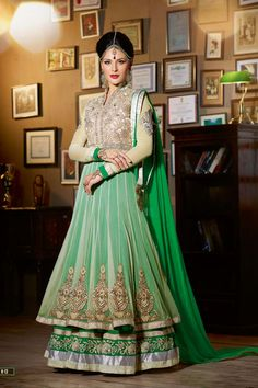 Floor length anarkali suit with lengha style look. The outfit exudes elegance with high neck collars and full length sleeves