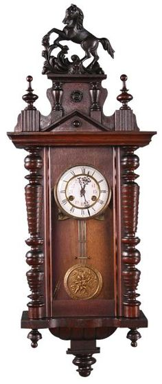 Antique clock, regulator clock with horse carving and cherubs on pendulum. Still strikes! Dates to 1900 by Schlenker+Kienzle. In our gallery at EuroLuxAntiques.com