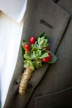 rustic boutonniere with tiny succulents and red hypericum berries wrapped in twine