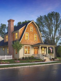 2 tone Dutch Colonial with shingles on the 2nd story + darker sashes.