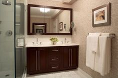 Master bathroom with tri fold medicine cabinet and double vanity