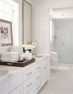 white bathroom...love the slight contrast of the light blue tile in the shower