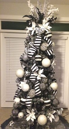 Dark gray/pewter tree with black, white, silver and bling ornaments