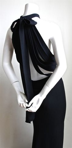 YVES SAINT LAURENT edition soir black silk evening gown with unique back   From a collection of rare vintage evening dresses at https://www.1stdibs.com/fashion/clothing/evening-dresses/