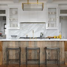 Salvage Wood Kitchen Island - Design photos, ideas and inspiration. Amazing gallery of interior design and decorating ideas of Salvage Wood Kitchen Island in dining rooms, kitchens, entrances/foyers by elite interior designers. Wood Kitchen Island, Brass Kitchen, New Kitchen, Kitchen Decor, Wooden Island, Kitchen Islands, Kitchen White, Wooden Kitchen, Kitchen Rustic