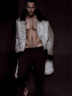 Model Noah Mills wearing a fur coat