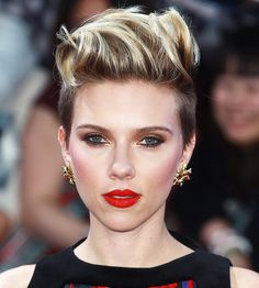 Scarlett Johannson with an edgy, punk-inspired updo and a bold red lip