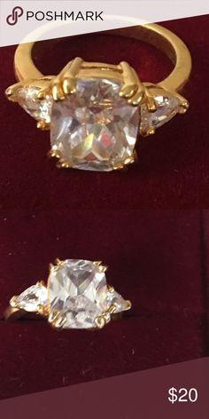 Beautiful diamond ring in gold setting Beautiful gold ring with Swarovski diamonds 1 center diamond and 2 adjoining smaller diamonds baublebar Jewelry Earrings